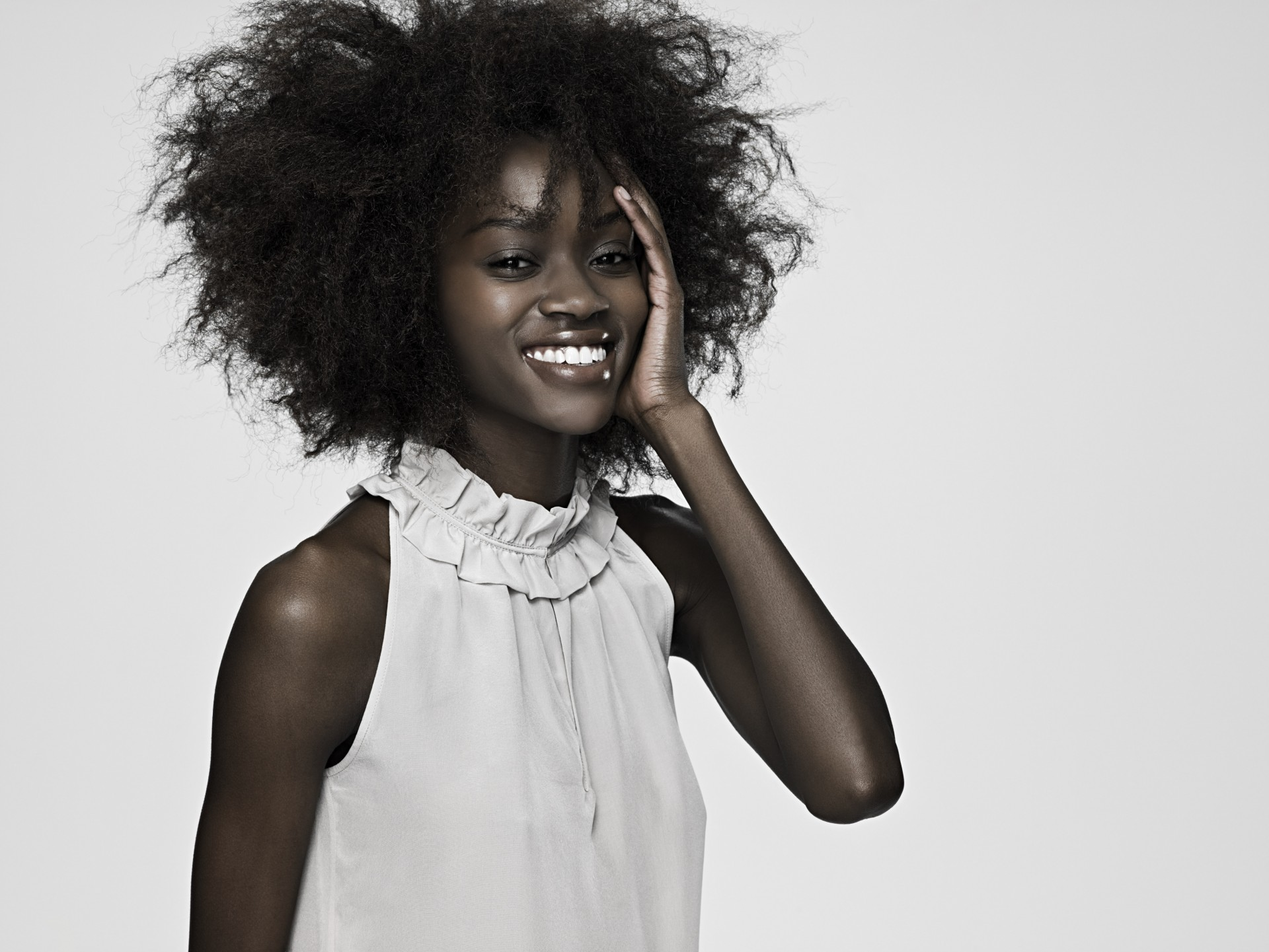 Beautiful young woman with an afro
